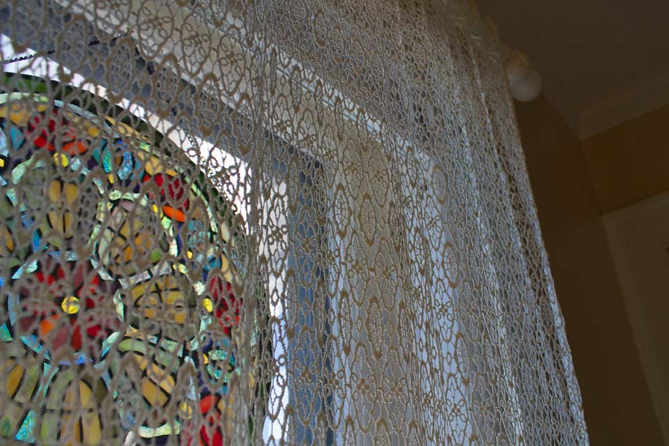Sunlight through Stained glass decorations in bathroom window of Room 4.
