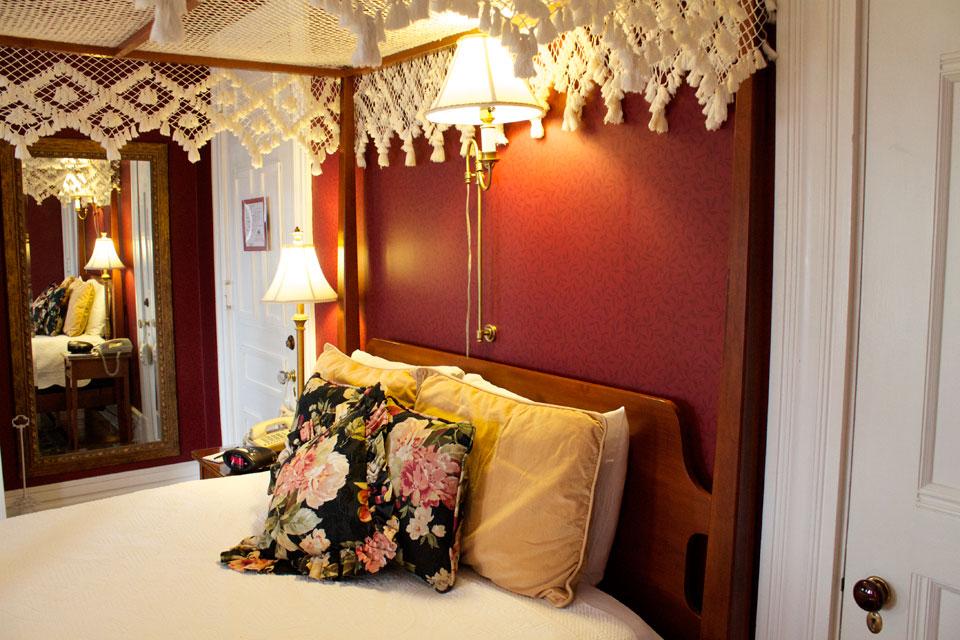 Plush beddings of queen, canopy bed in Room 4 of the Willard Inn, Burlington.