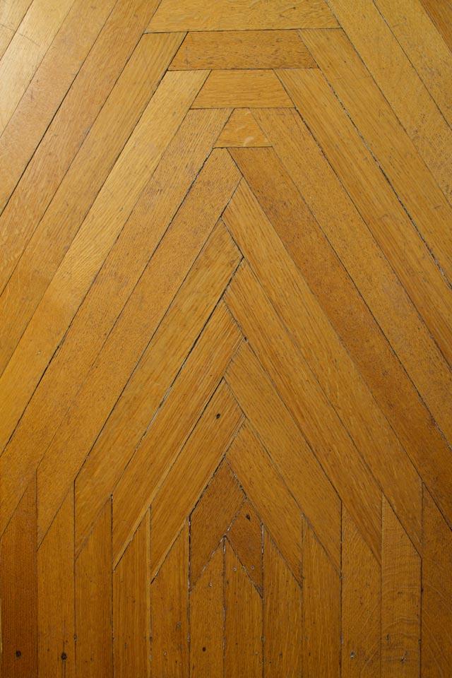 1881 oak flooring detail of Room 4 at WSInn burlington, vt.