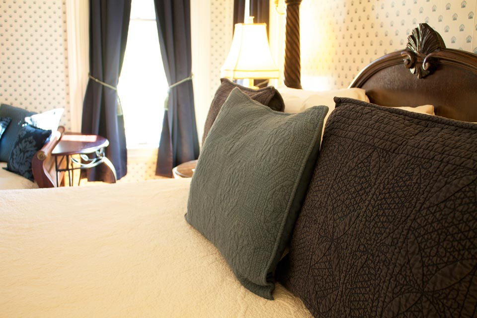 Plush linens invite you to relax in the king bed of Room 5 at the Willard Inn, Burlington, vt.