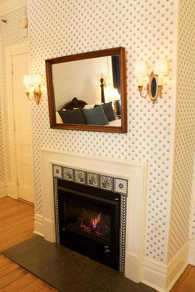 Gas fireplace with mosiac tile at Willard Street Inn a burlington, vermont bed and breakfast.