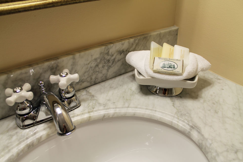 Marble vanity and high end amenities included with your stay in the Suite Larkin.