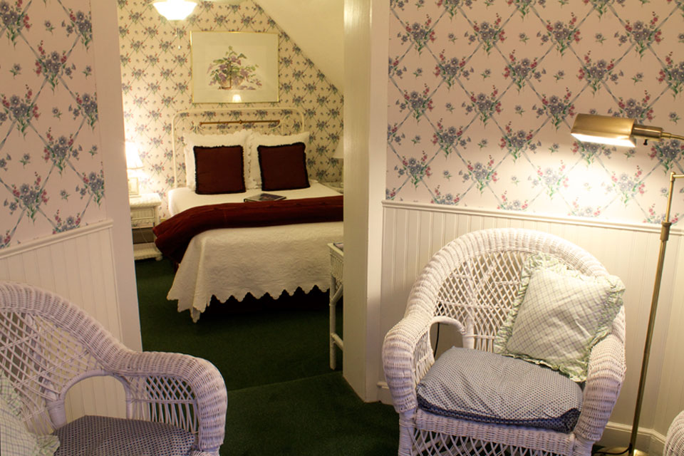 Matching wicker chairs invite you to grab a good book and relax in this New England B&B.