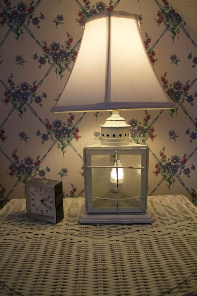 Lamp on wicker bedside table in Room 12 at WSInn, Vermont.