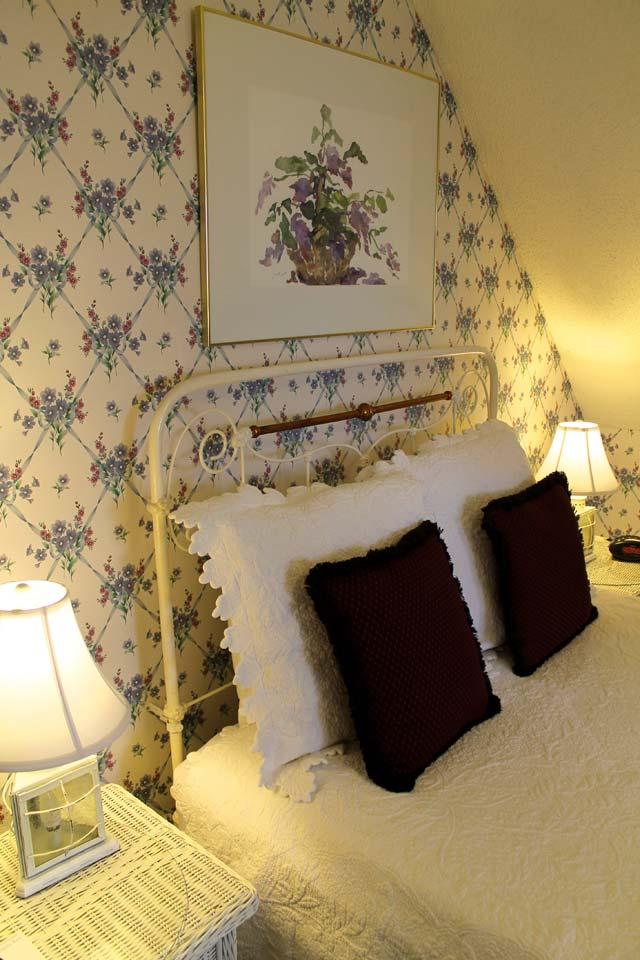 Original artwork hanging above queen bed in the Tower Room.