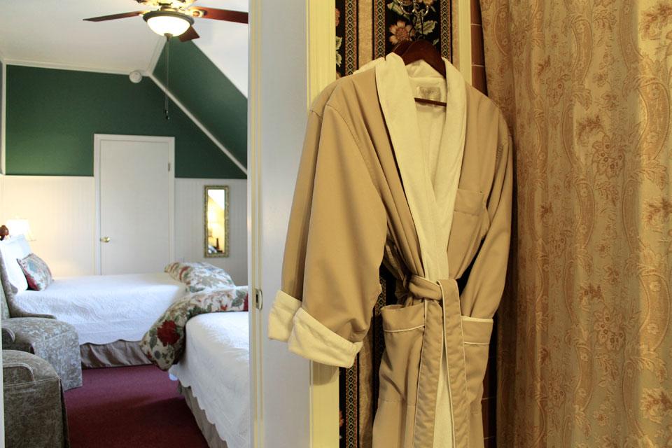 Plush bathrobes hang in the private bath of Room 14 of Burlington, VT's WSINn.