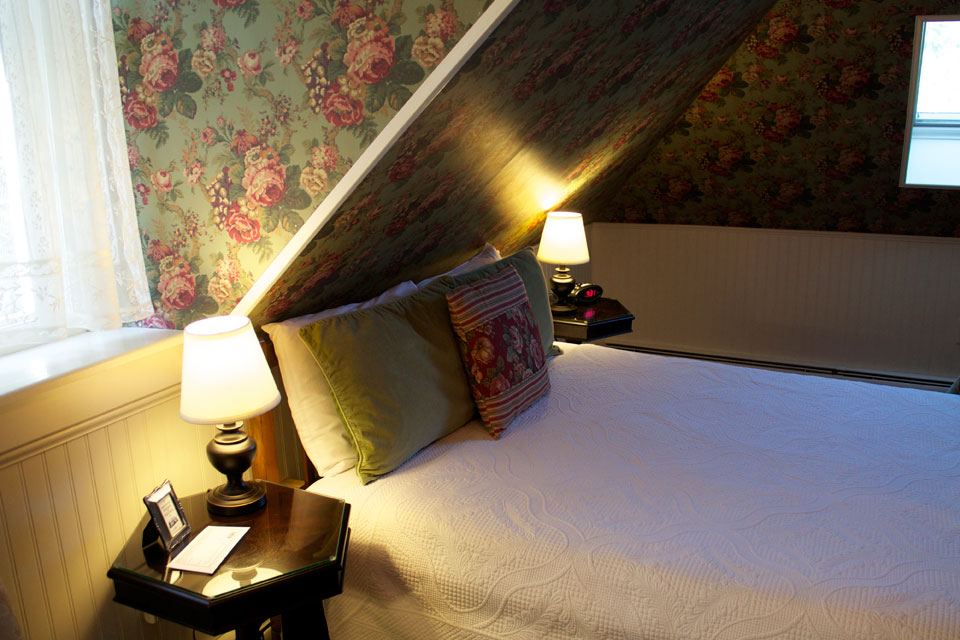Stone-topped bedside tables frame the queen bed cozied up under the vaulted ceilings in Alexandra's Alcove.