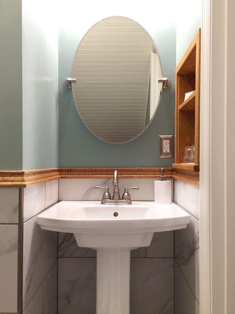 Pedestal SInk, oval mirror, and custom oak wall shelf complete the bathroom's vanity area in the Rose Garden Room at the Willard St Inn, VT.