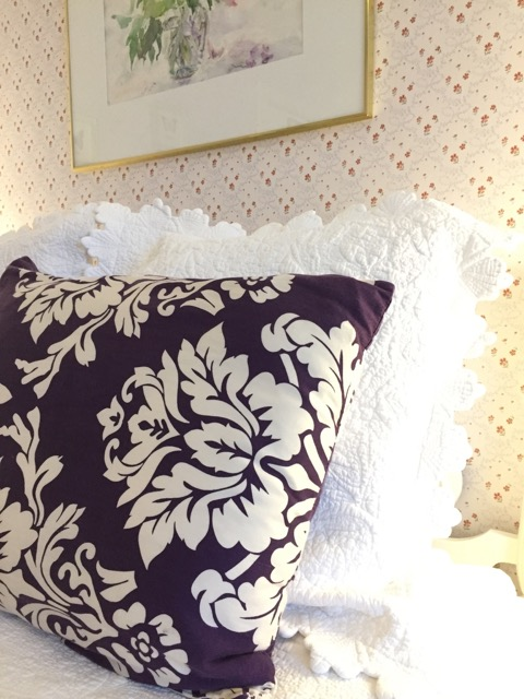 Plush linens and pillows appoint the queen bed of Room 9.