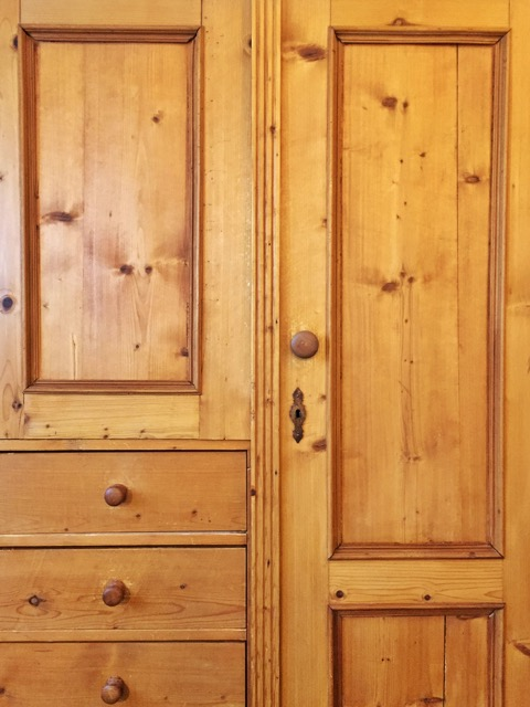 RIchly Amber colored front of Large Pine Wardrobe in Room 9 at WSInn, Vermont.