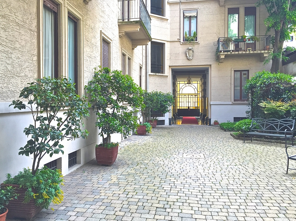 Traditional Milanese Garden in the center of my building. The marble staircase and elevator are just beyond the door to the left.