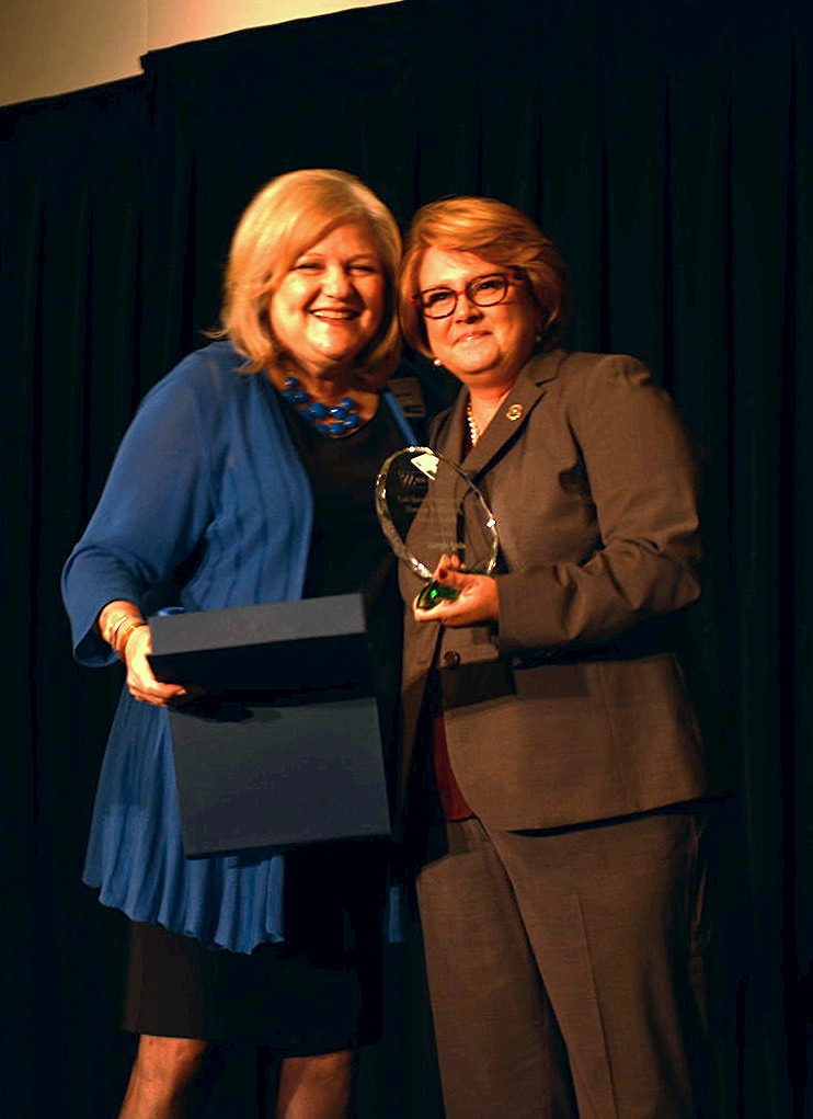 Derri Smith with first Human Trafficking Impact Award recipient, Margie Quin of TBI.