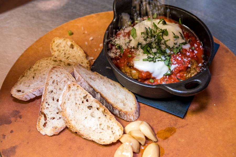 Meatballs al Forno at Italian: 4 House made meatballs with roasted marinara, fresh mozzarella, market baguette and roasted garlic.