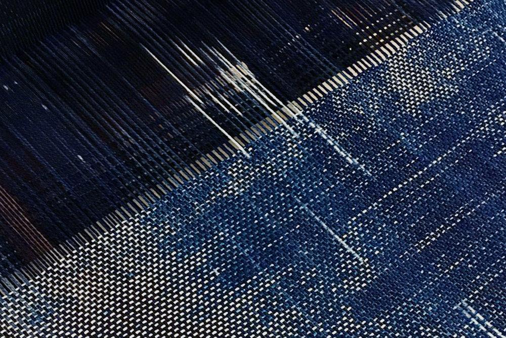 Close up/Indigo Ikat dyed warp woven with cyanotype wefts