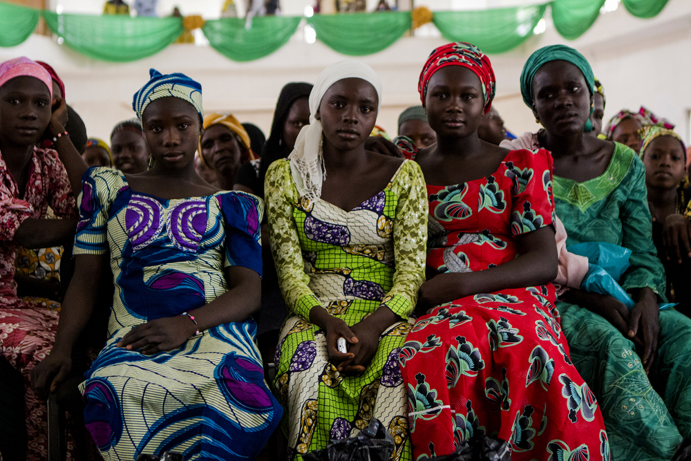 Yola, Nigeria. March 1 2015. Women who have fled Boko Haram violence wait for a food distribution after Sunday mass at a local church.