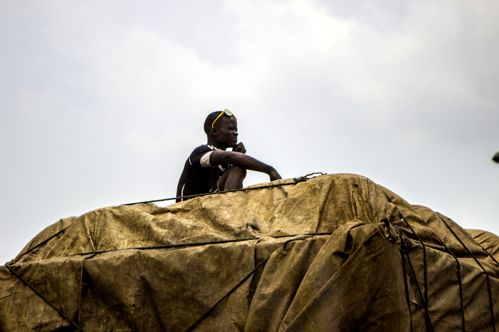 A boy rides on top of a transport truck in Lagos on Feb 25, 2015.