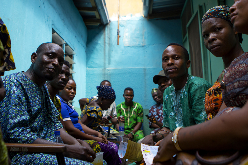 Lagos, Nigeria. Feb. 25, 2015. Agbodemu Ishola, a local politician and activist, meets with members of the Makoko neighborhood to discuss community issues and the upcoming election.