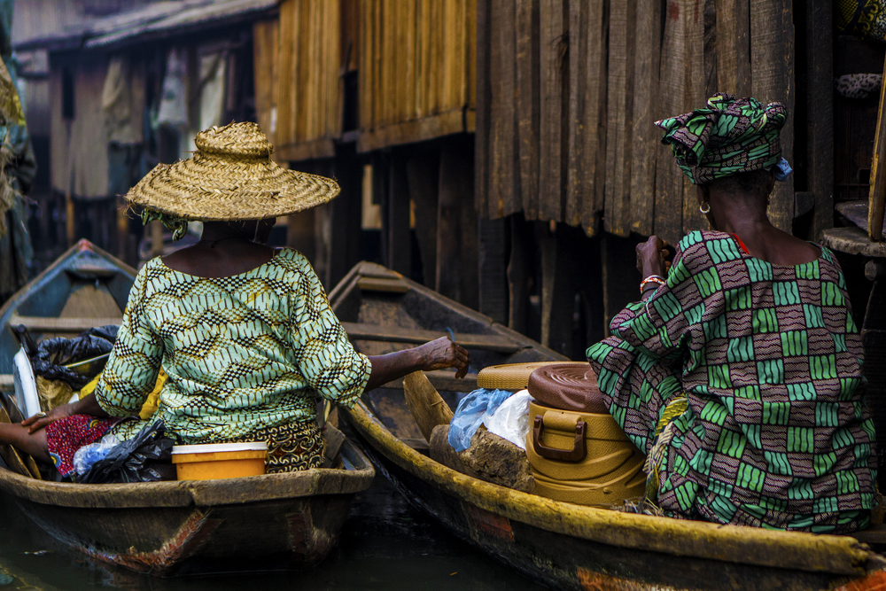 Two women pause to talk in the floating slum of Makoko in Lagos, Nigeria on Feb. 25 2015.