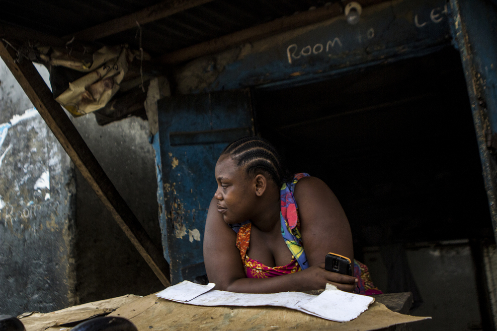 A woman waits for a text message on the outskirts of Makoko, in Lagos on Feb. 25 2015.