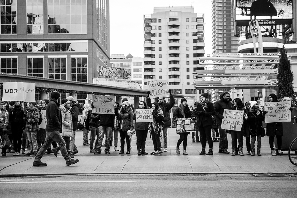 Dozens of people met at Yonge-Dundas Square in Toronto, Canada on Nov. 22, 2015 to show their support for Canadian initiatives to resettle refugees, especially those coming from Syria. The demonstration came a little over a week after the Nov. 13 Paris attacks that sparked a handful of attacks on Muslims around the world, including Canada. Demonstrators said they hoped to combat this sentiment. | Kathleen Caulderwood.
