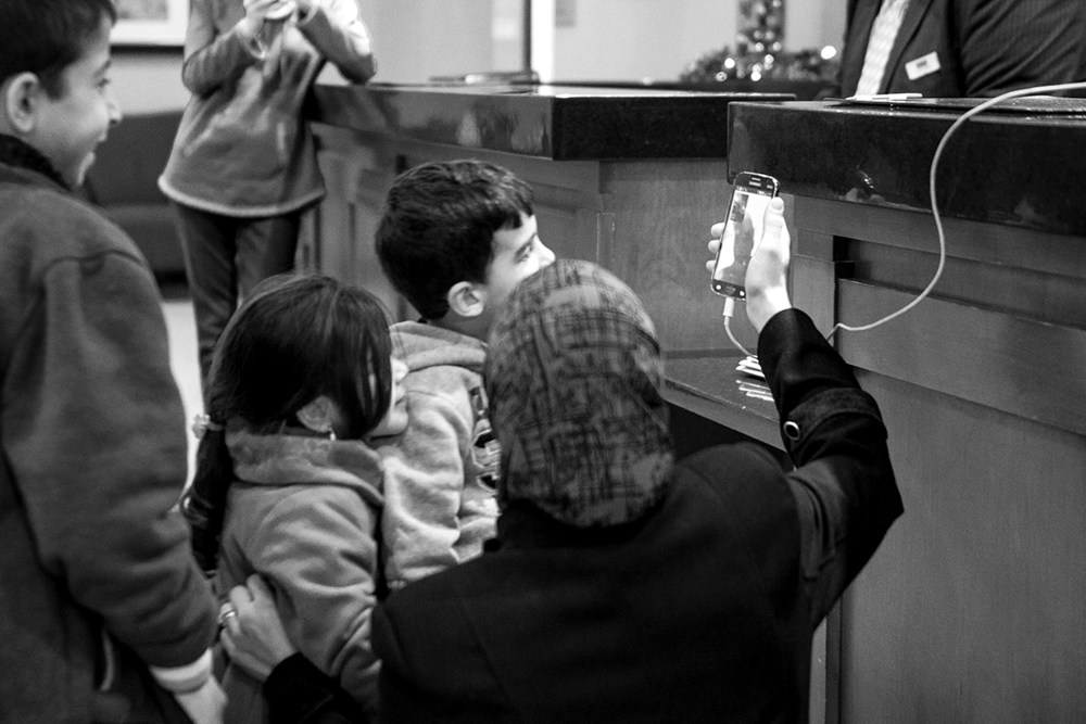 A family uses their cell phone to communicate using video chat on Dec. 21, 2015 in Toronto, Ontario. | Kathleen Caulderwood