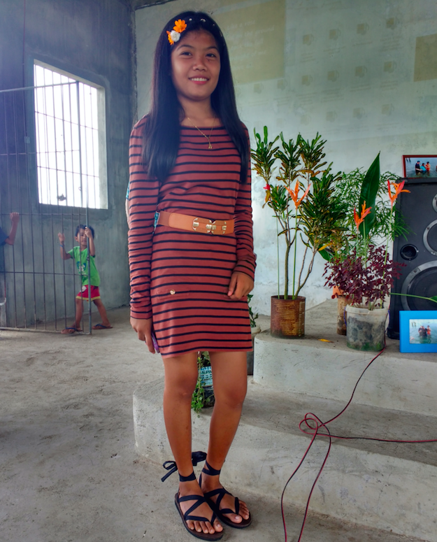 Elisa, pictured above, with her pair of Sseko Ribbon Sandals