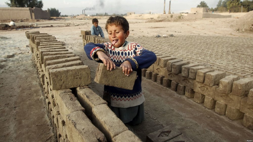 Children work at a brick-making factory in Jalalabad, Dec. 17, 2013.