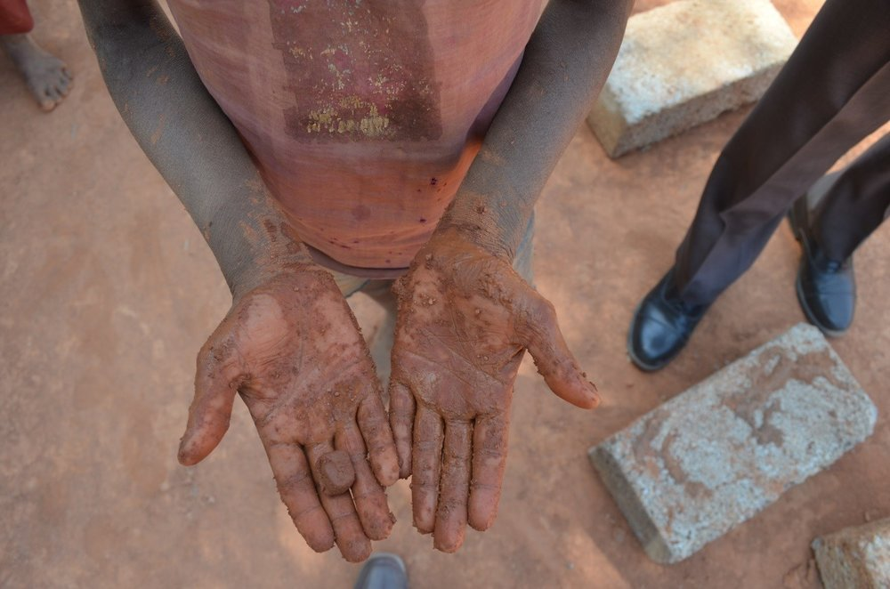A young child mixes mud to make bricks just before IJM and the Anti-Human Trafficking Unit (AHTU) showed up at a brick kiln near Bangalore to free 25 bonded laborers.