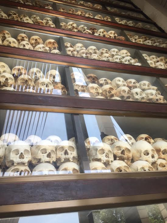 "Skulls line the walls of a memorial at ""The Killing Fields"" in Cambodia where millions were murdered."