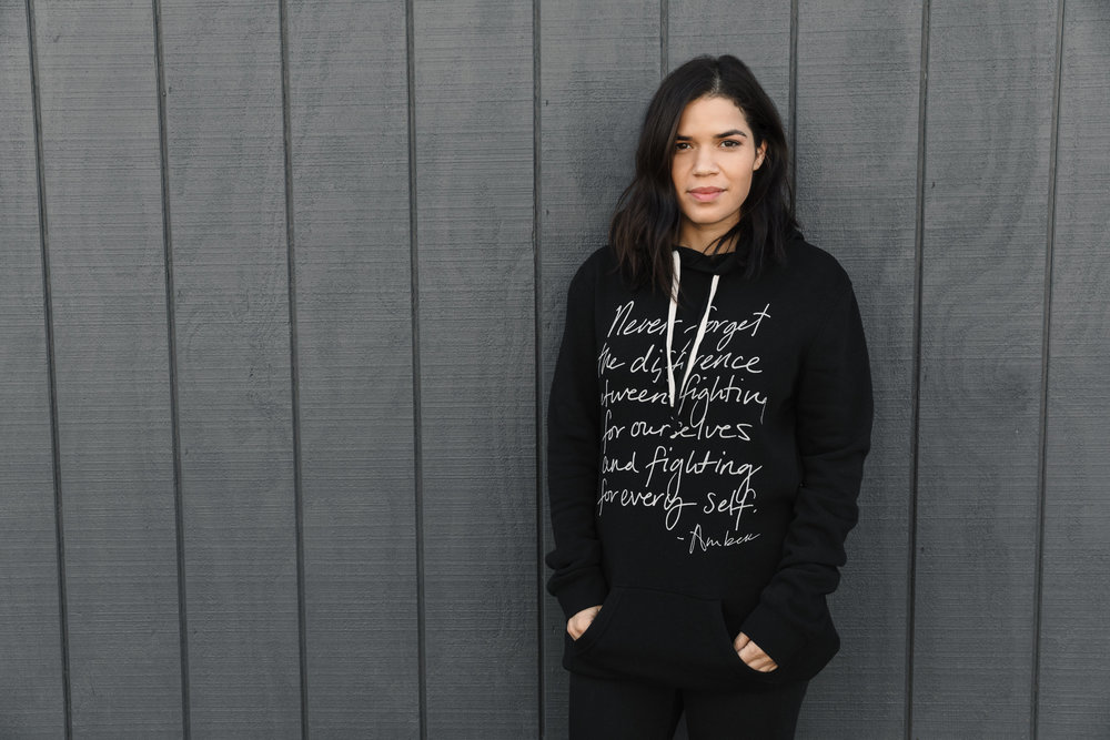 "America Ferrera wearing the  ""Fight for Every Self""  Tunic Hoodie"