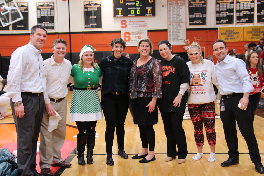 Somerville High School staff and students, pictured above, after being pied in the face by members of the student body.