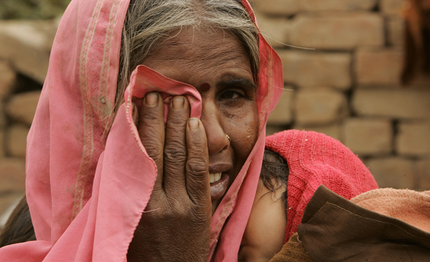 A rural Indian woman cries over the birth of her eighth daughter, despite three sex-selective abortions. (AP)
