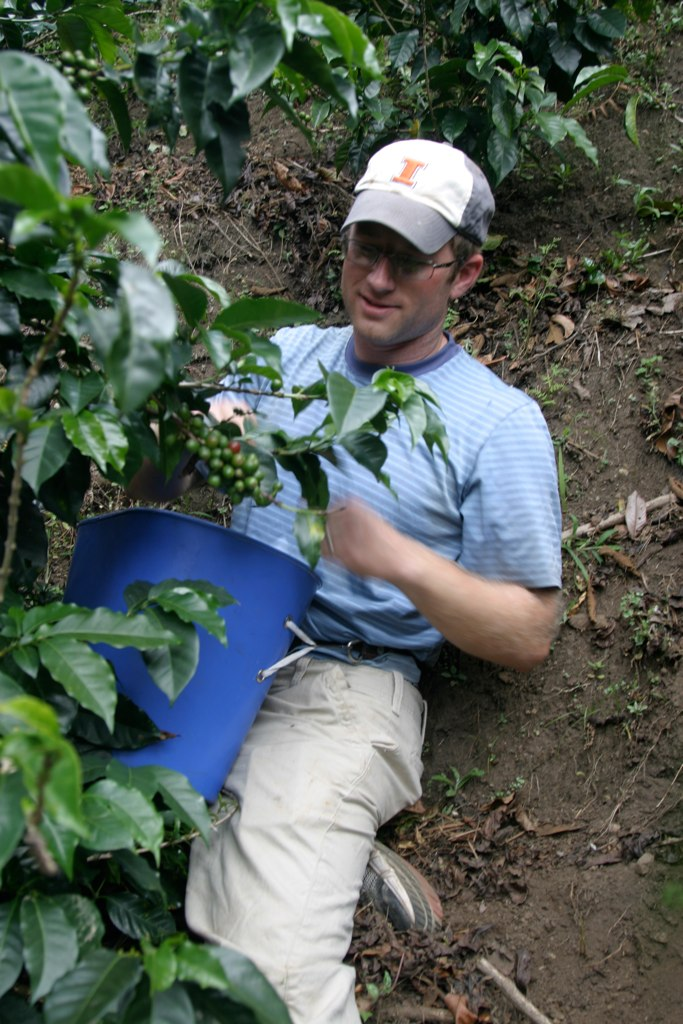 Photo of Timmerman learning the work of coffee farmers in Colombia in 2012, photo courtesy of:  http://whereamiwearing.com/press-kit/