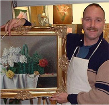 Delmus with one of his paintings