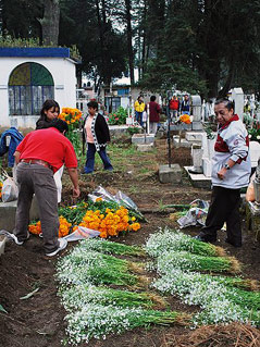 Cleaning and decorating graves Photo credit: AlejandroLinaresGarcia