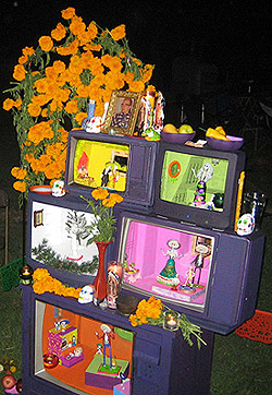 Altar constructed from painted, hollowed-out TV sets. Photo credit: LAVisitor