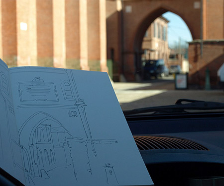 Sketching an arch at a church in Pollenzo, Italy