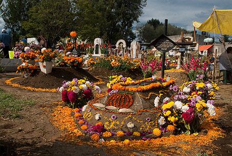 Graveyard decorated with marigolds for Dia de los Muertos Photo credit: Eneas de Troya