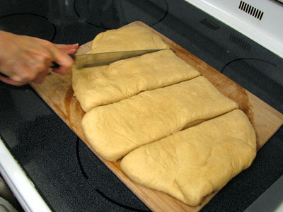 Dividing the Pan de Muerto Dough