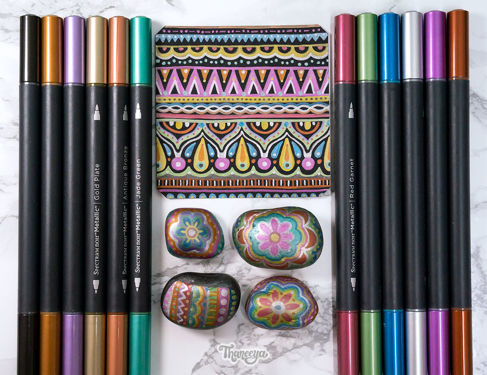Spectrum Noir Metallic Markers on black paper and rocks, a review by Thaneeya McArdle