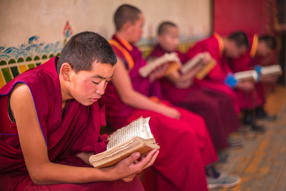 Monks preparing for prayers and chanting