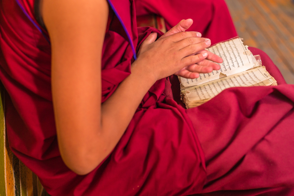 Monk with prayer book