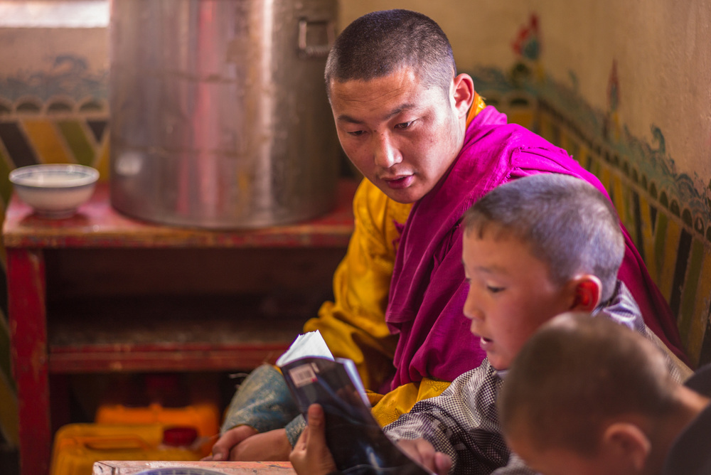 Monk sitting with Mongolian boys