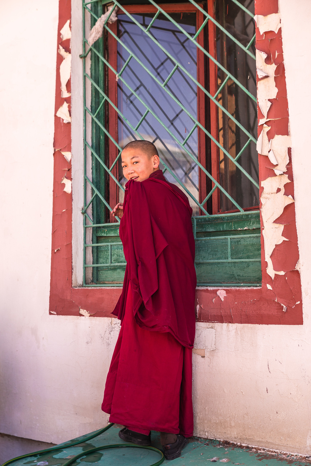 Young monk checking up on his fellow monks