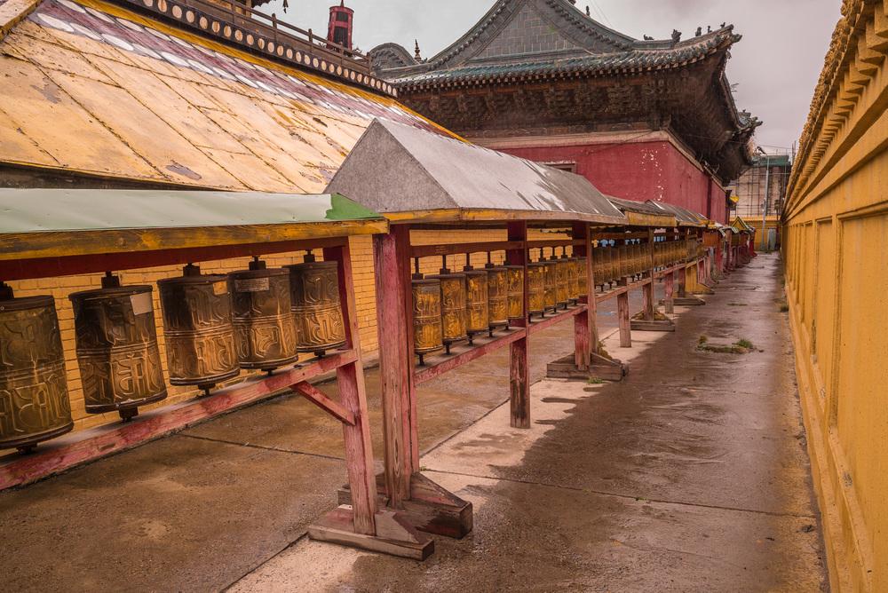 Prayer wheels outside of main temple