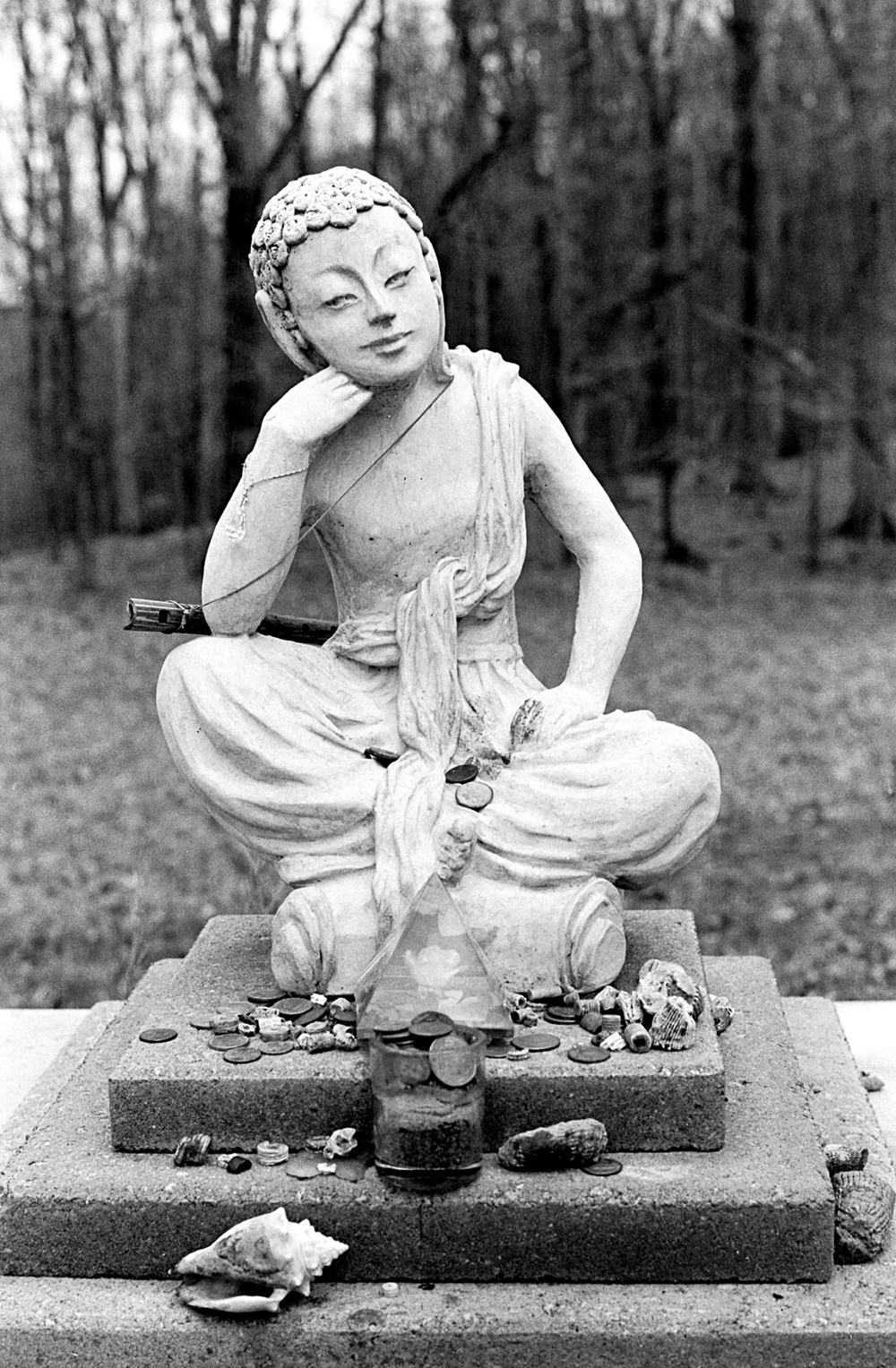 Buddha statue with nontraditional offerings