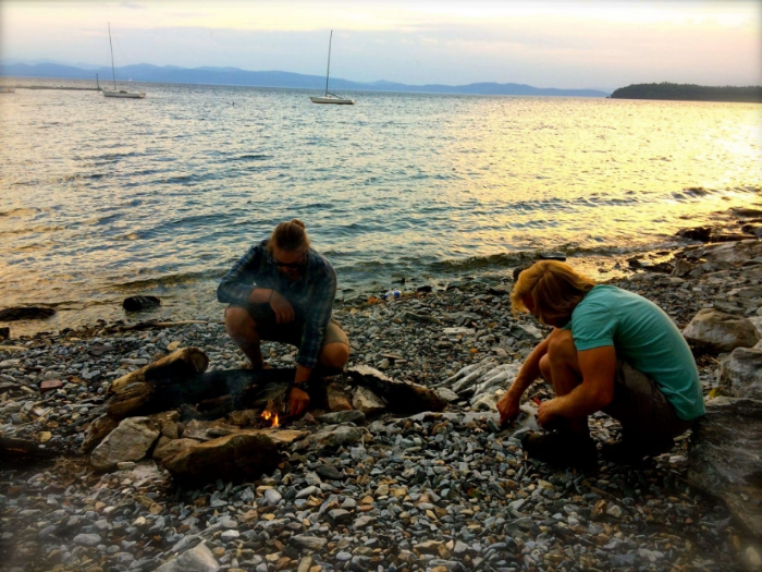Kyle and Lucas preparing a fire for a Full Moon ceremony on the shores of Lake Champlain