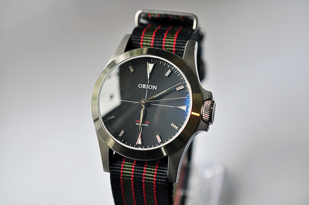 The red dial variant of the Orion: 1
