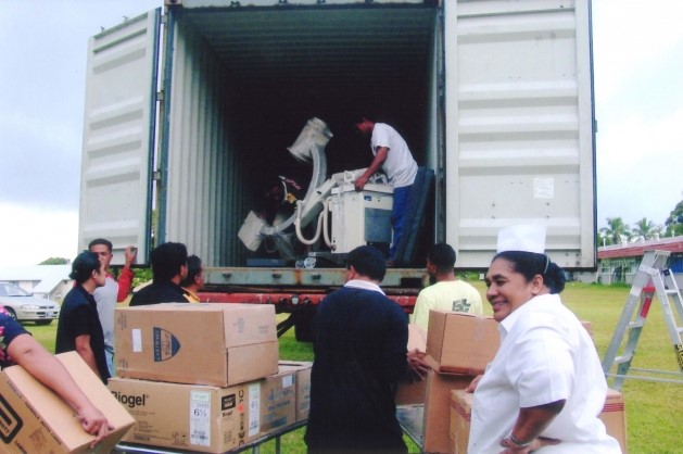Supplies from a cargo container full of supplies being unloaded at its destination