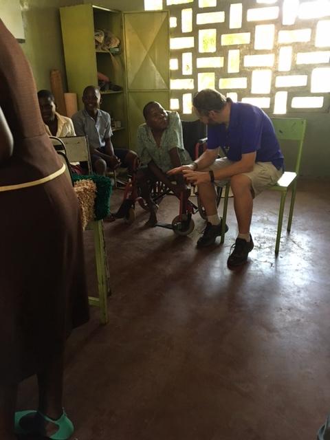 Hanzi's teacher talking with a team member.